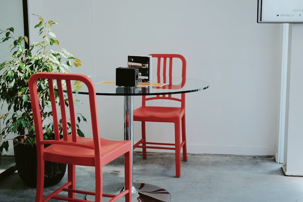 red plastic chair beside black table