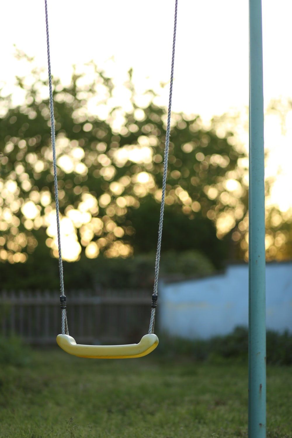yellow and black swing chair