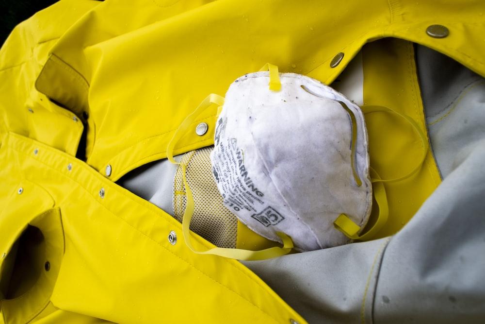 white helmet on yellow textile