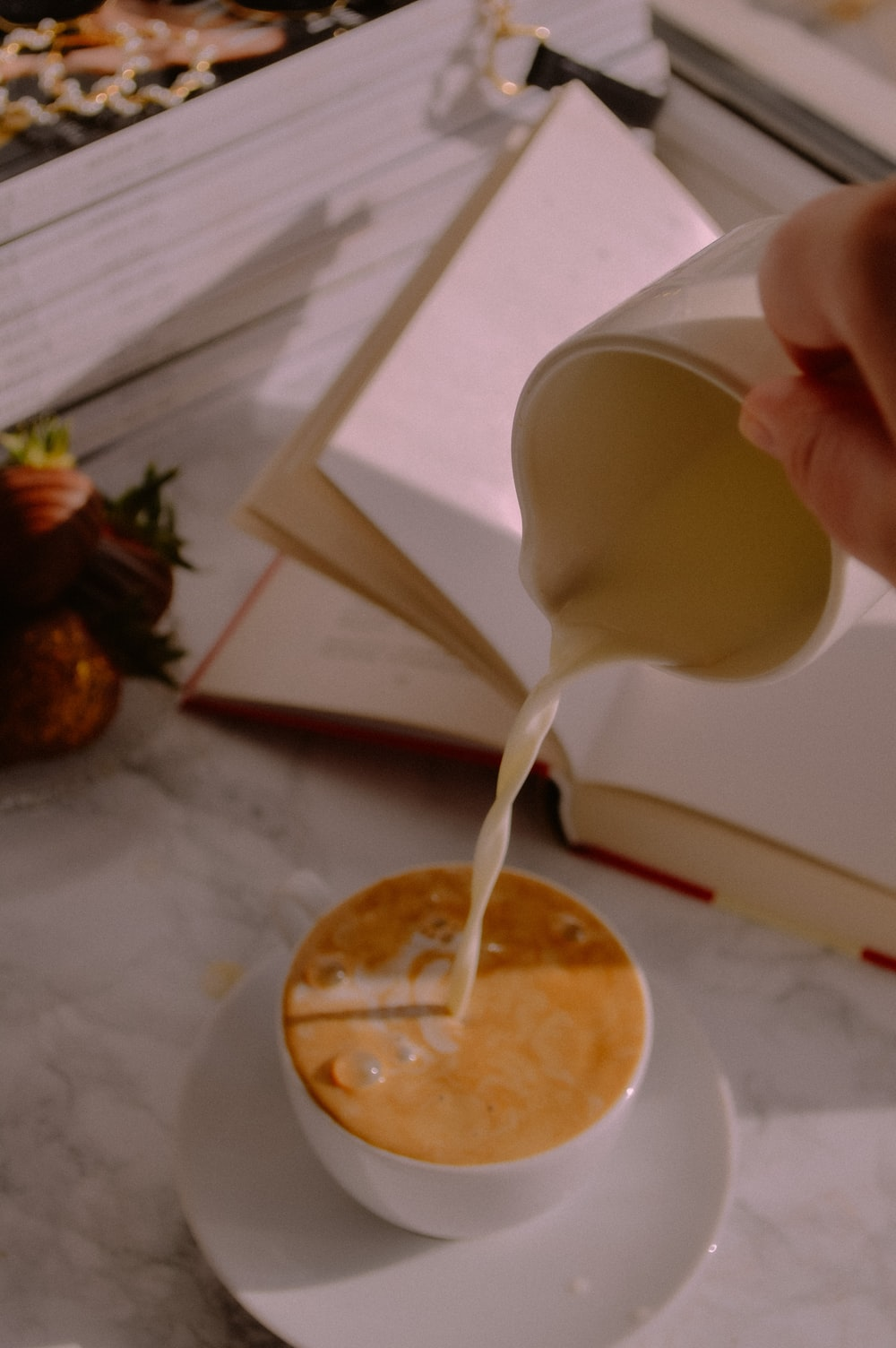 white plastic spoon on white ceramic plate