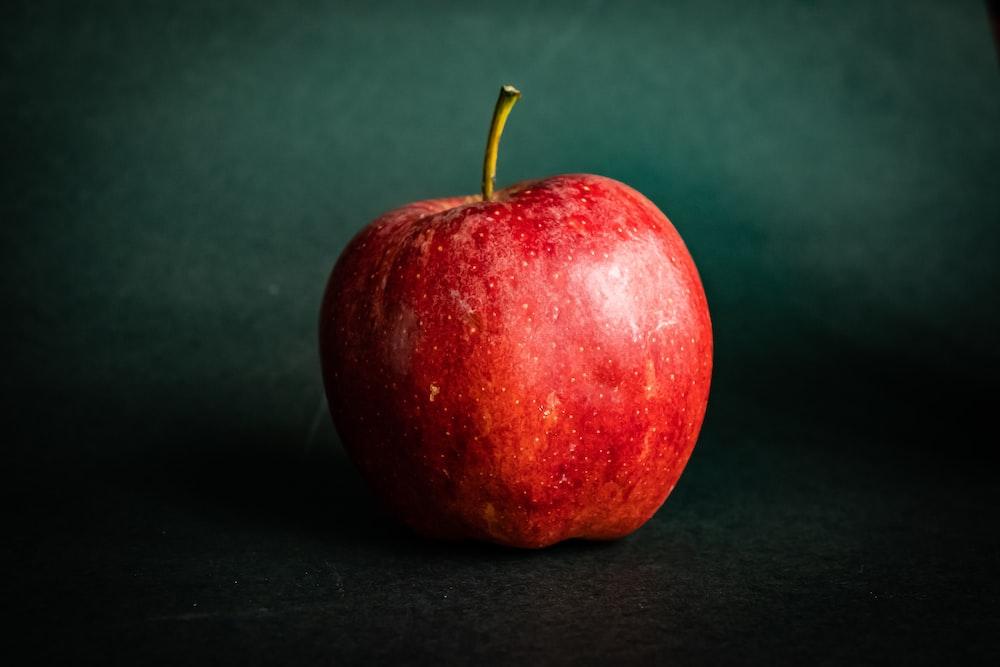 red apple fruit on black textile
