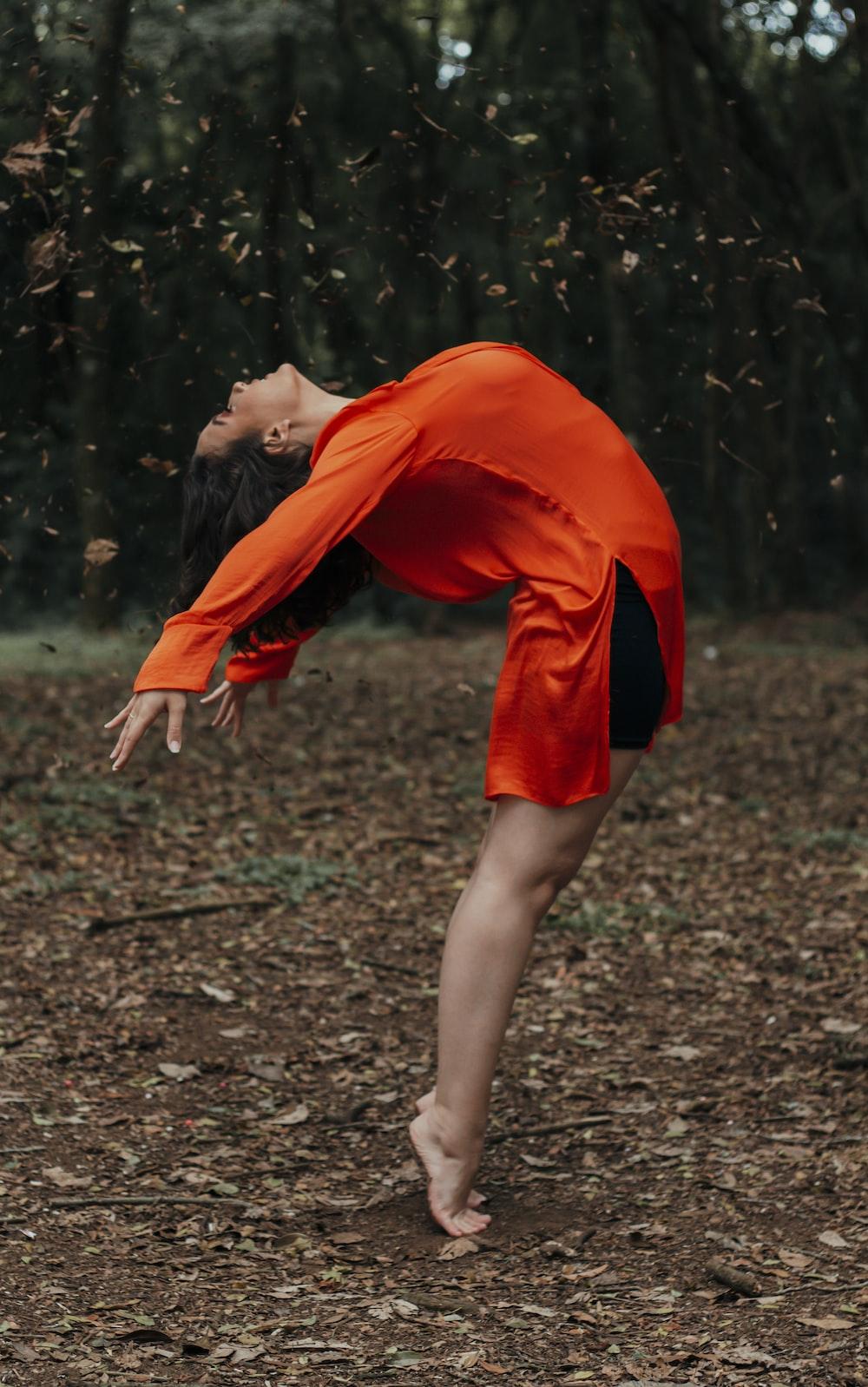 woman in orange dress standing on ground
