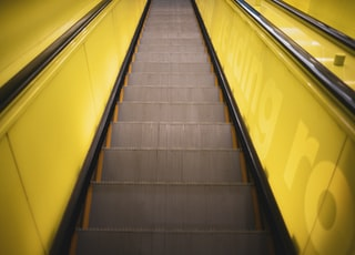 black and yellow escalator in close up photography