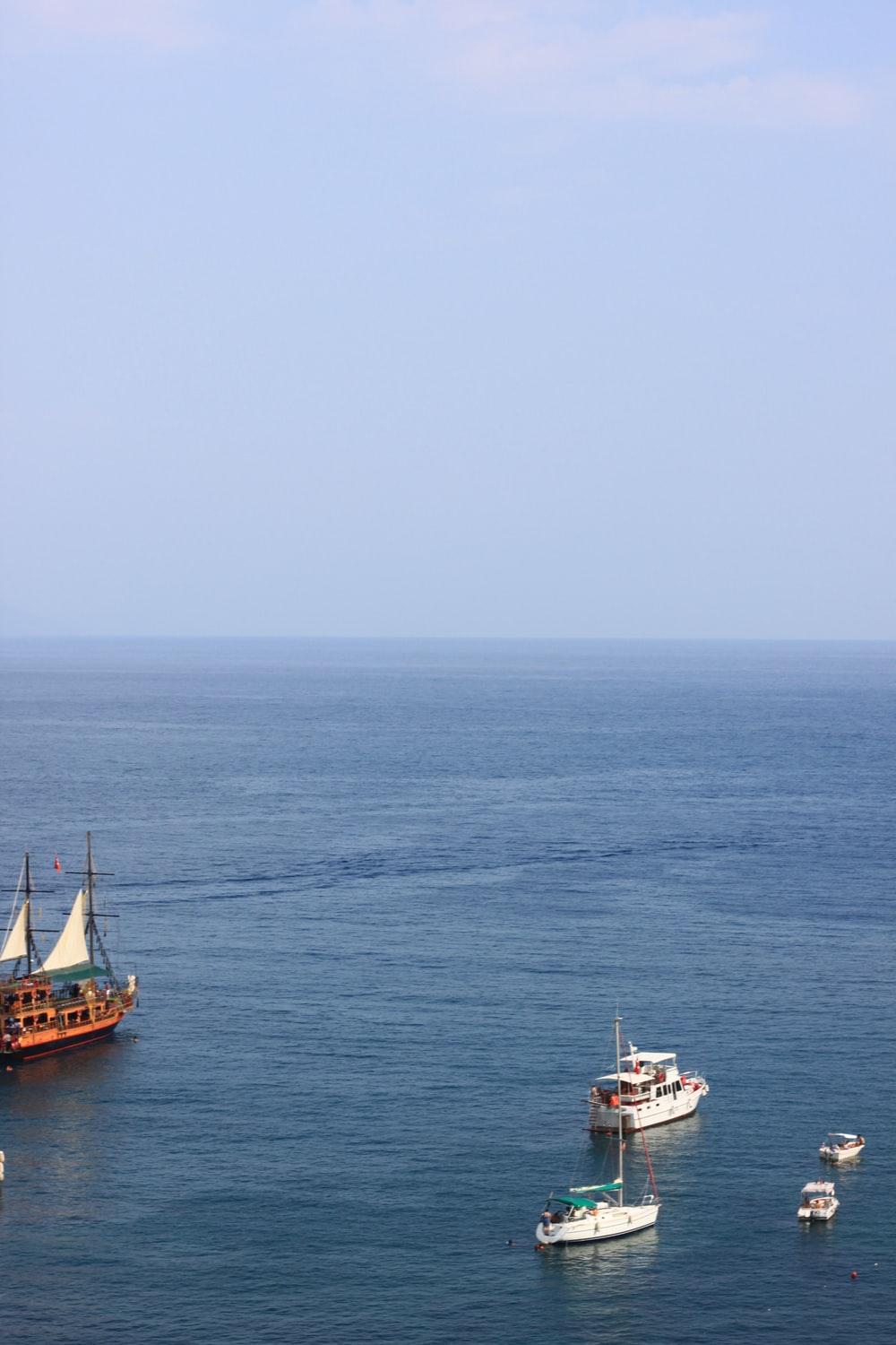 brown and white ship on sea during daytime