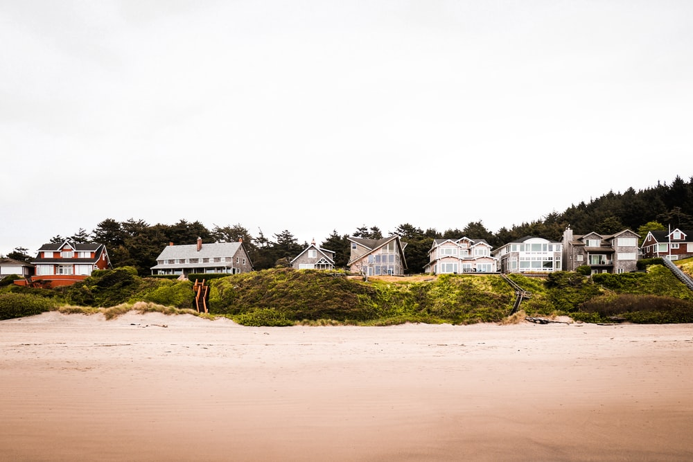 white and brown house on brown sand during daytime