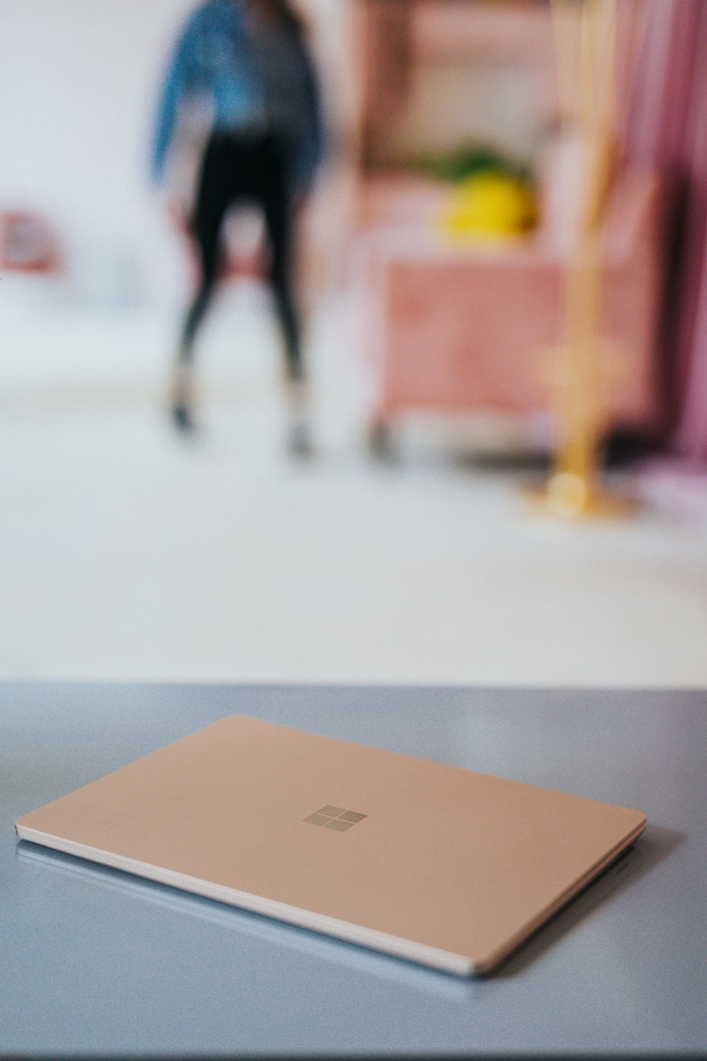 Microsoft Surface laptop on gray table