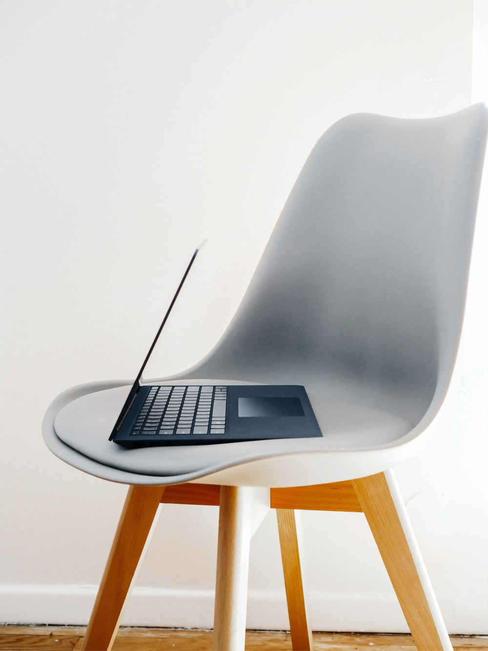 microsoft surface laptop on white chair