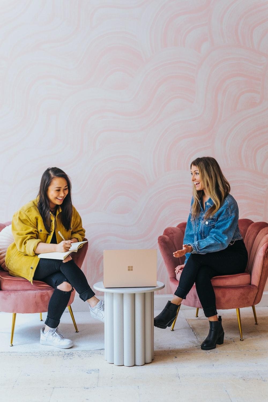 3 women sitting on chair