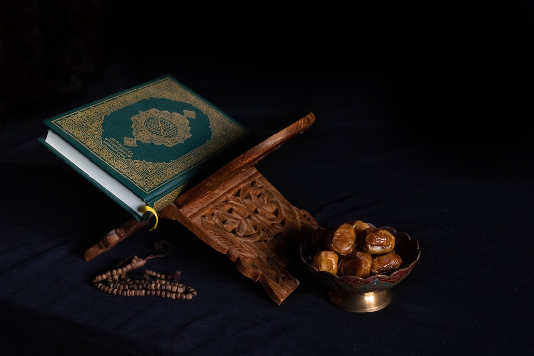 Quran The Holy Book and a Bowel of Dates, Dark Background