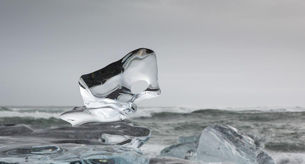 white ice on gray rock
