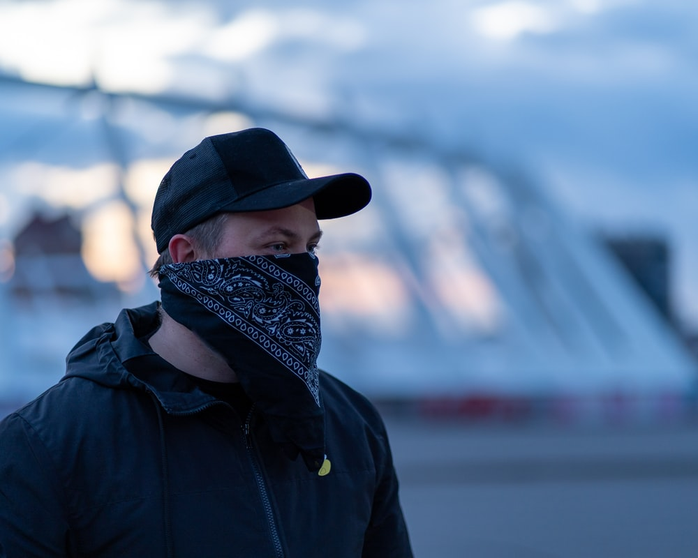 person in black jacket and black and white knit cap