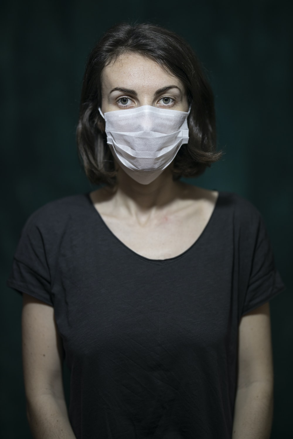 woman in black scoop neck shirt with white face mask