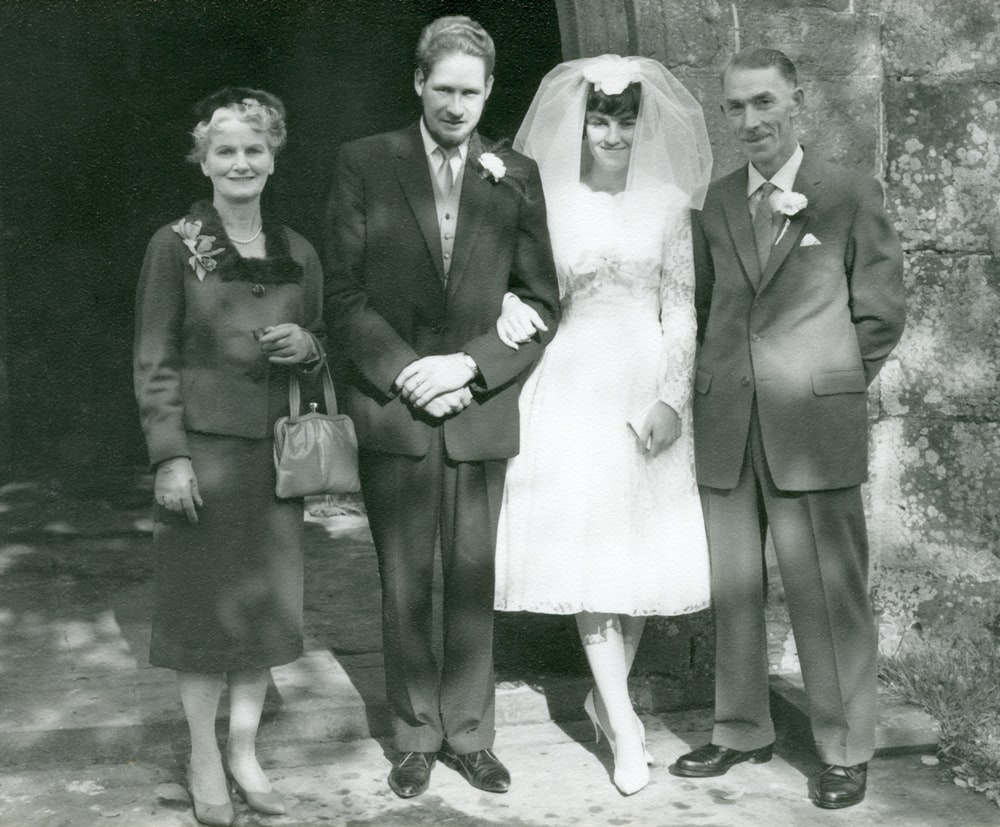 grayscale photo of man and woman in formal suit