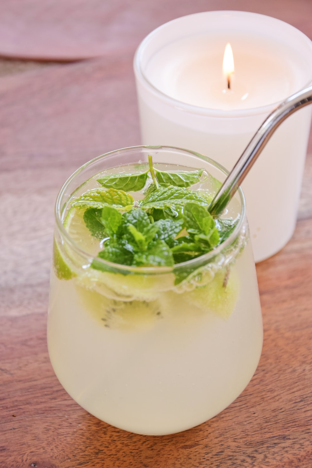 clear drinking glass with white liquid and green leaves