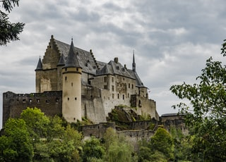 grey concrete castle under grey sky