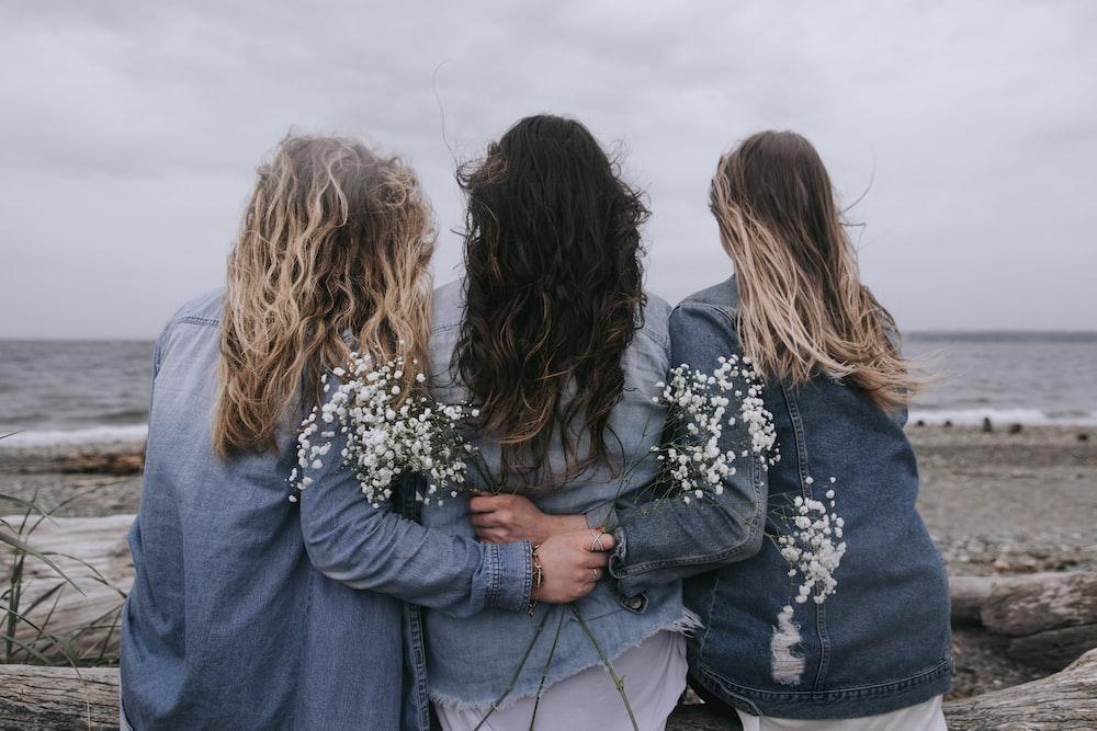 2 women in blue denim jacket