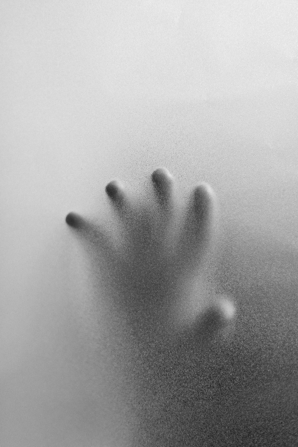 grayscale photo of persons right hand