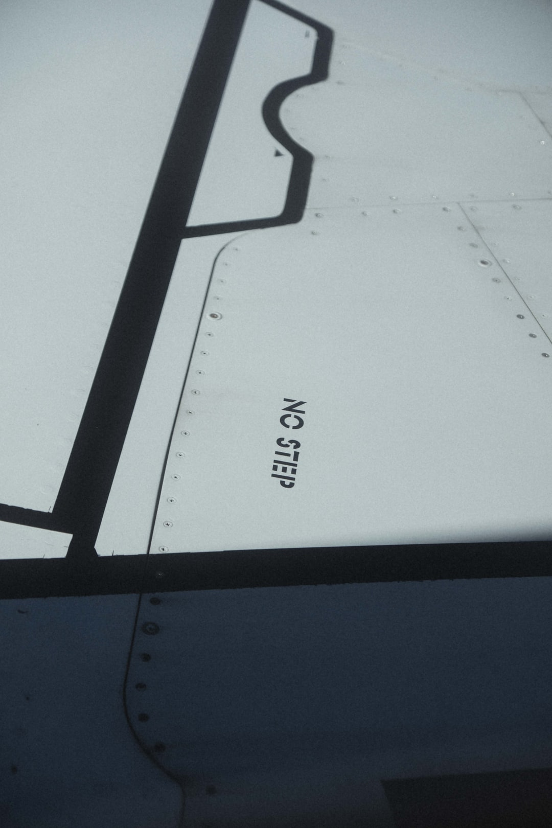 part of an airplane wing that says 'no step'