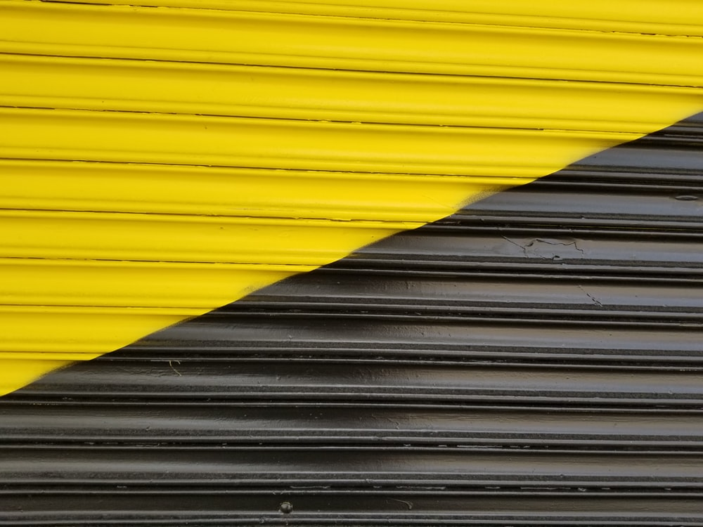 yellow and black wooden wall
