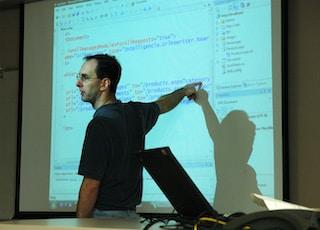 man in black crew neck t-shirt using black laptop computer