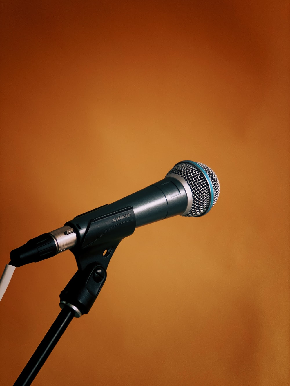 black and gray microphone on microphone stand