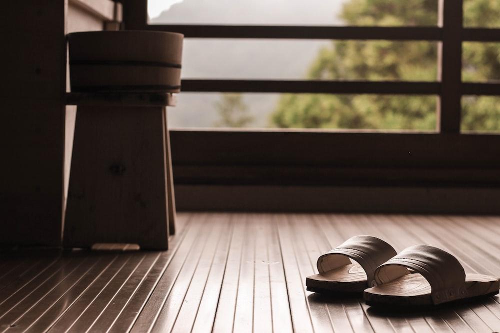 brown wooden seat near brown wooden window