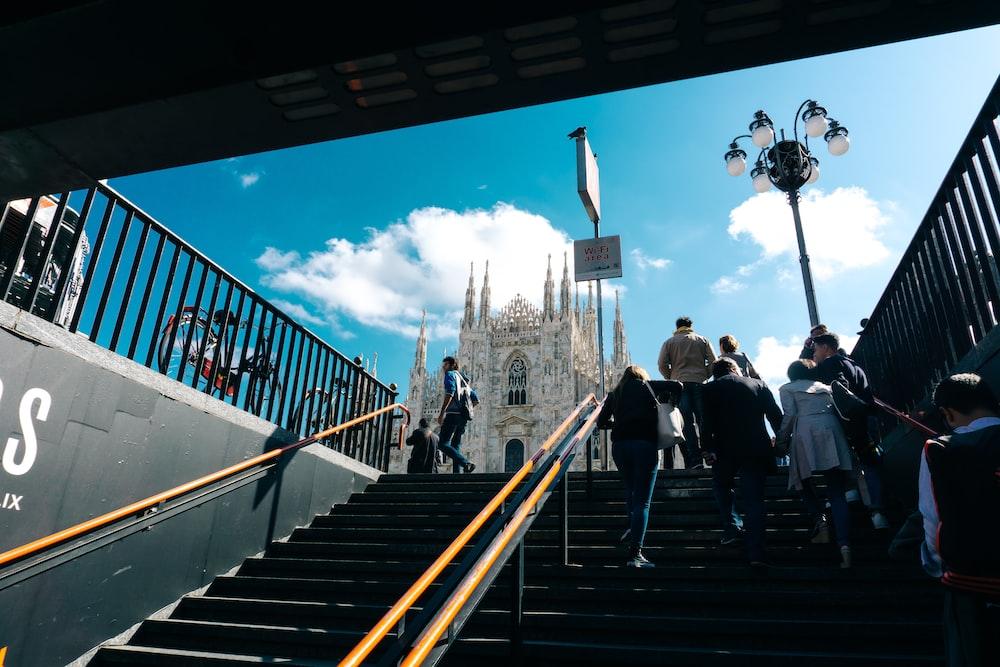 people walking on stairs during daytime