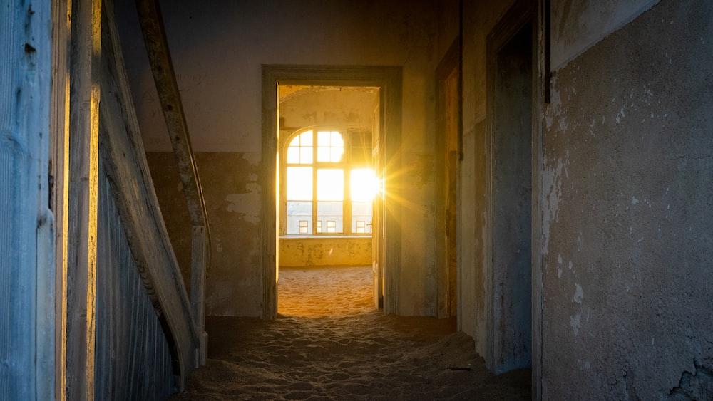brown wooden door in gray concrete hallway