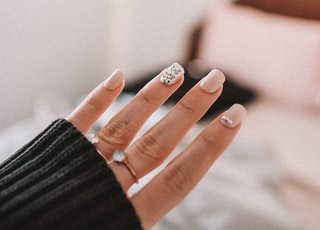 person wearing silver ring and black long sleeve shirt