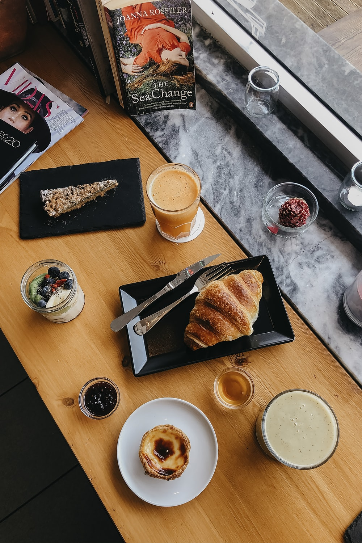 sliced bread on white ceramic plate beside white ceramic mug with coffee