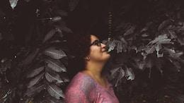 woman in pink scoop neck shirt wearing black sunglasses