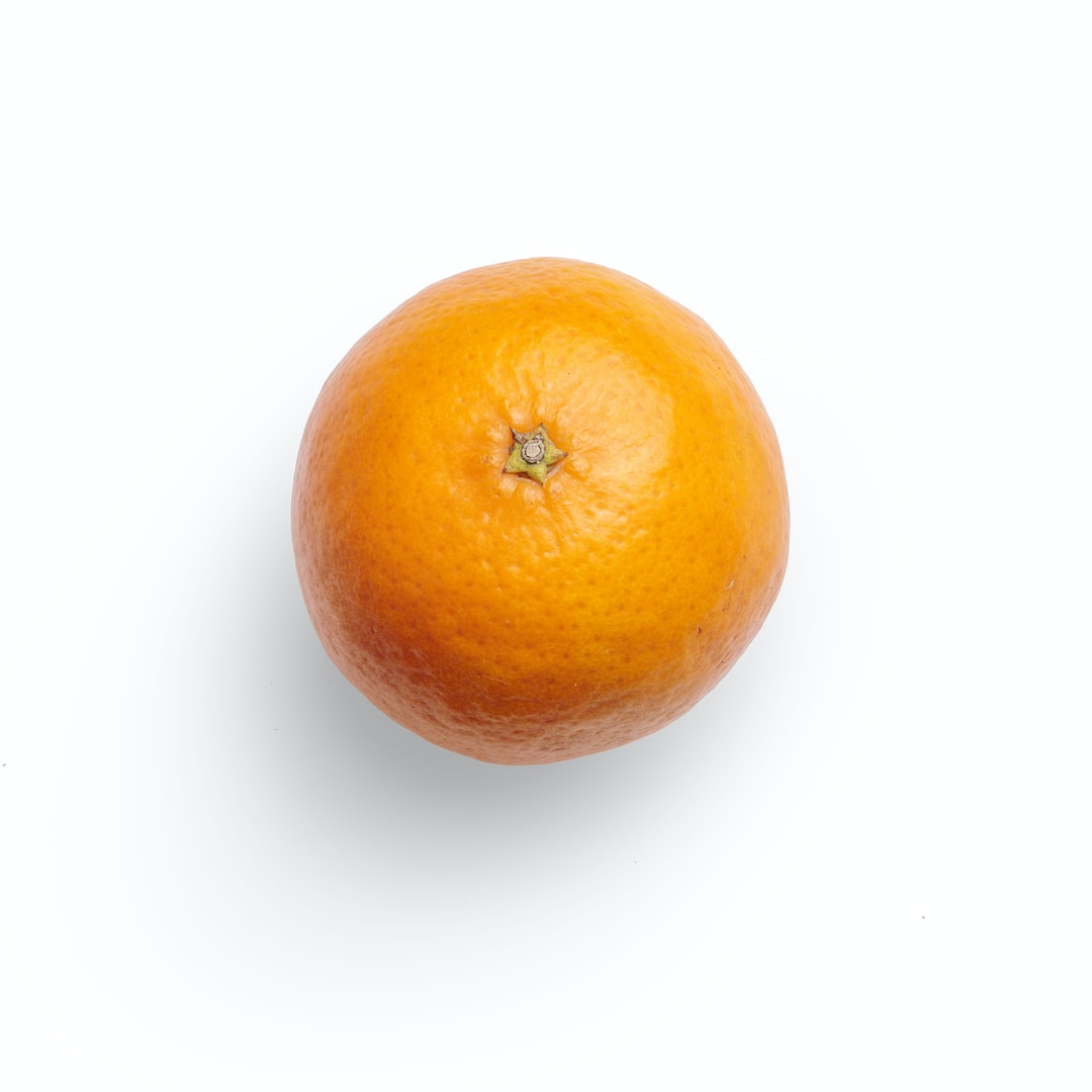 A high-quality photo of a juicy tangerine on a white background