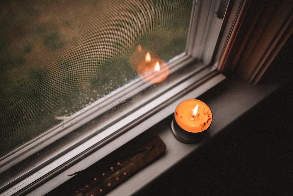orange pumpkin on window during daytime