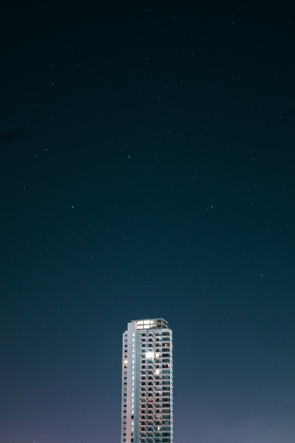white high rise building during night time