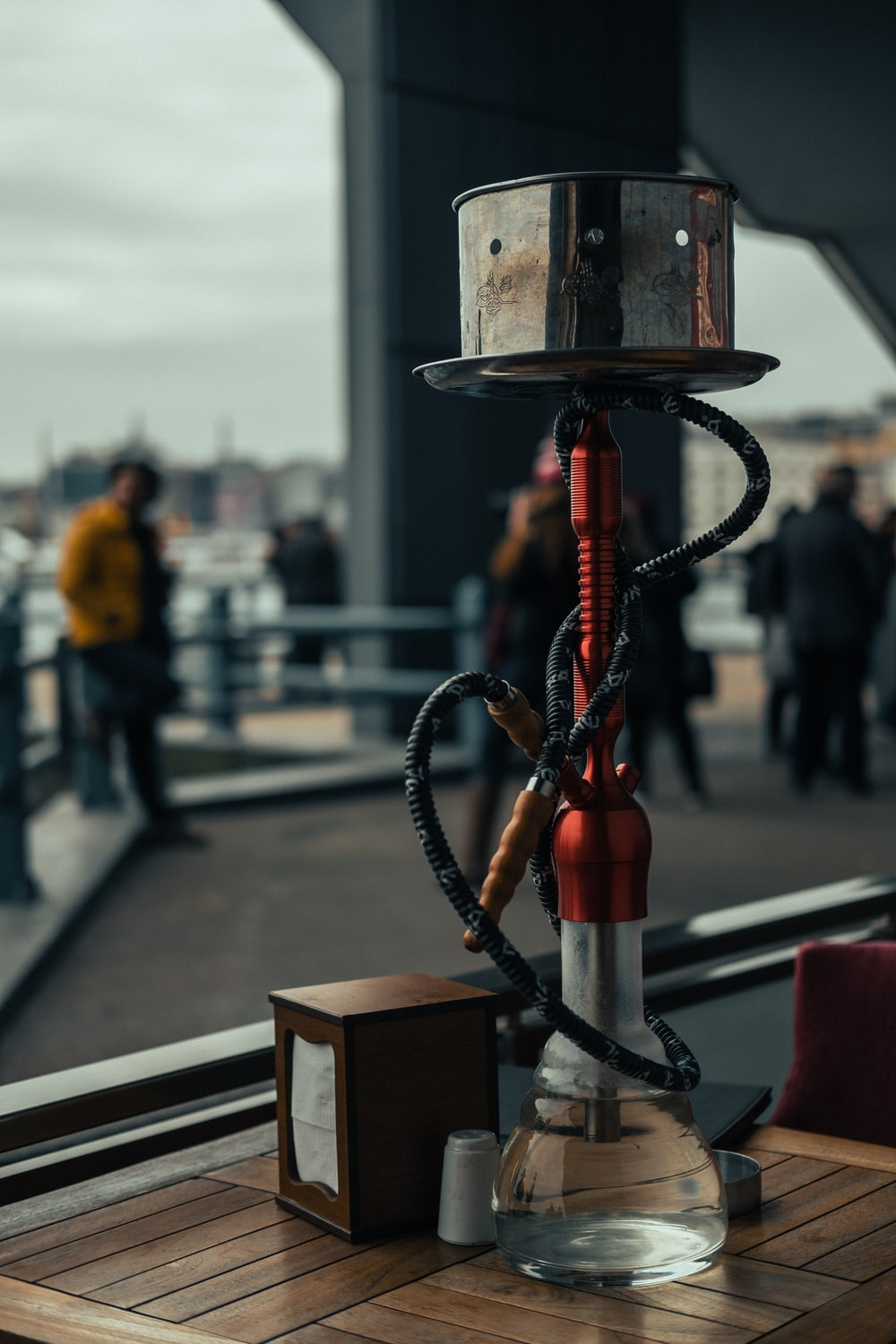 red and black hookah on brown wooden table