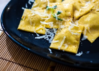 yellow cheese on black plate