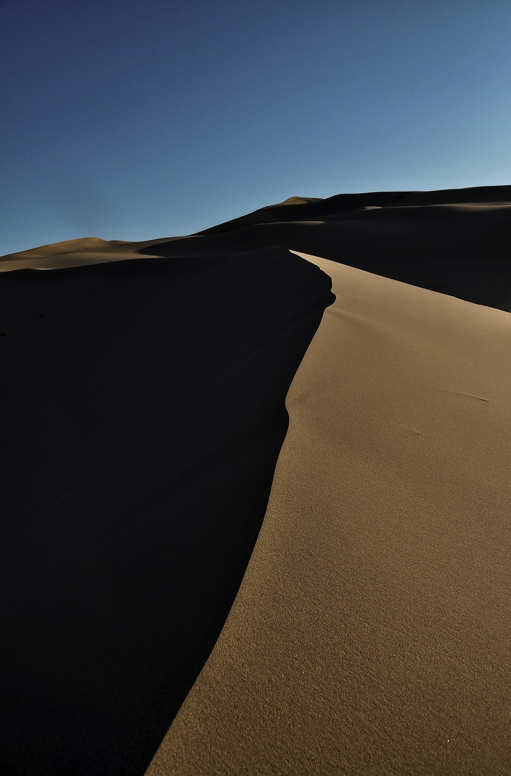 black sand under blue sky during daytime