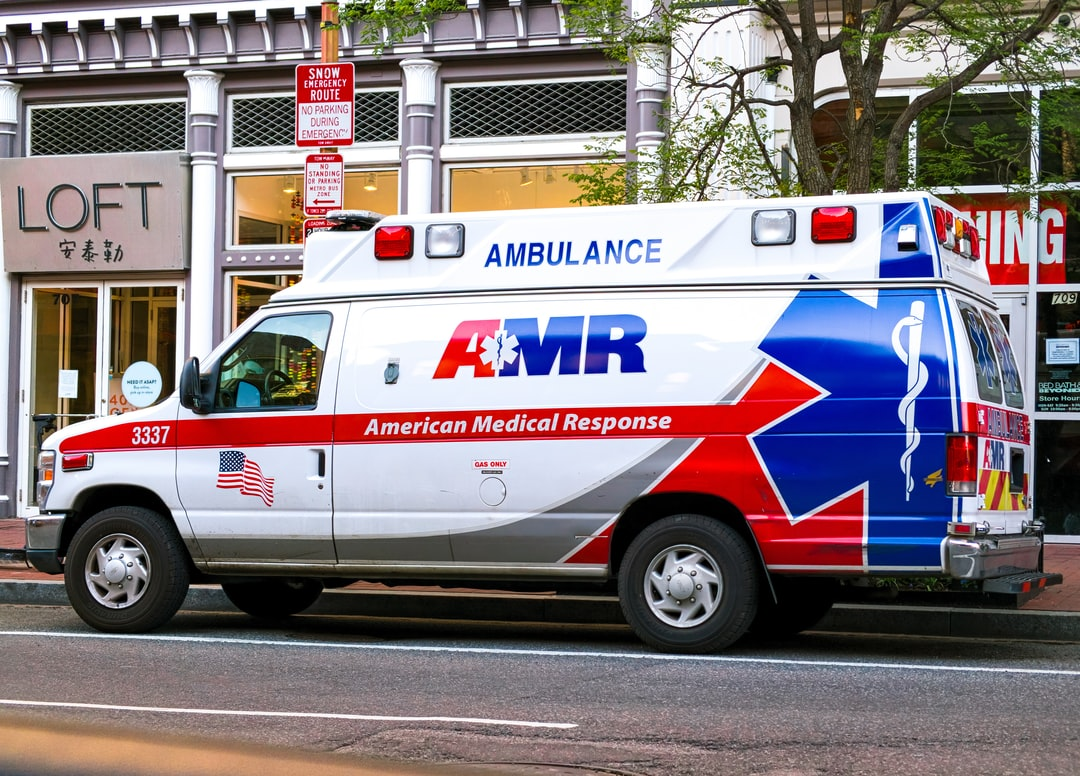 A first responder ambulance parked outside of Ann Taylor Loft in China Town, Washington DC during the Coronavirus pandemic.