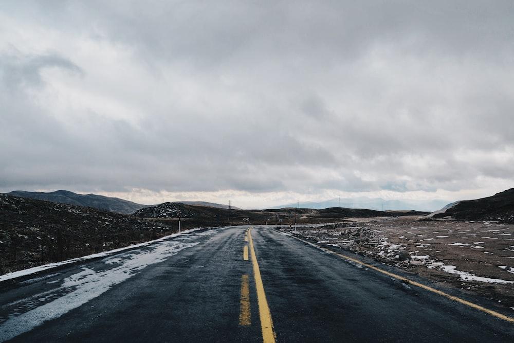 gray concrete road under gray sky