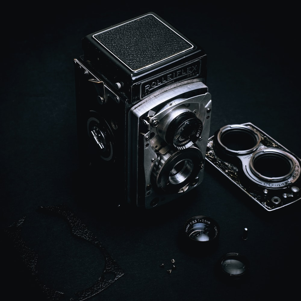 black and silver camera on black surface