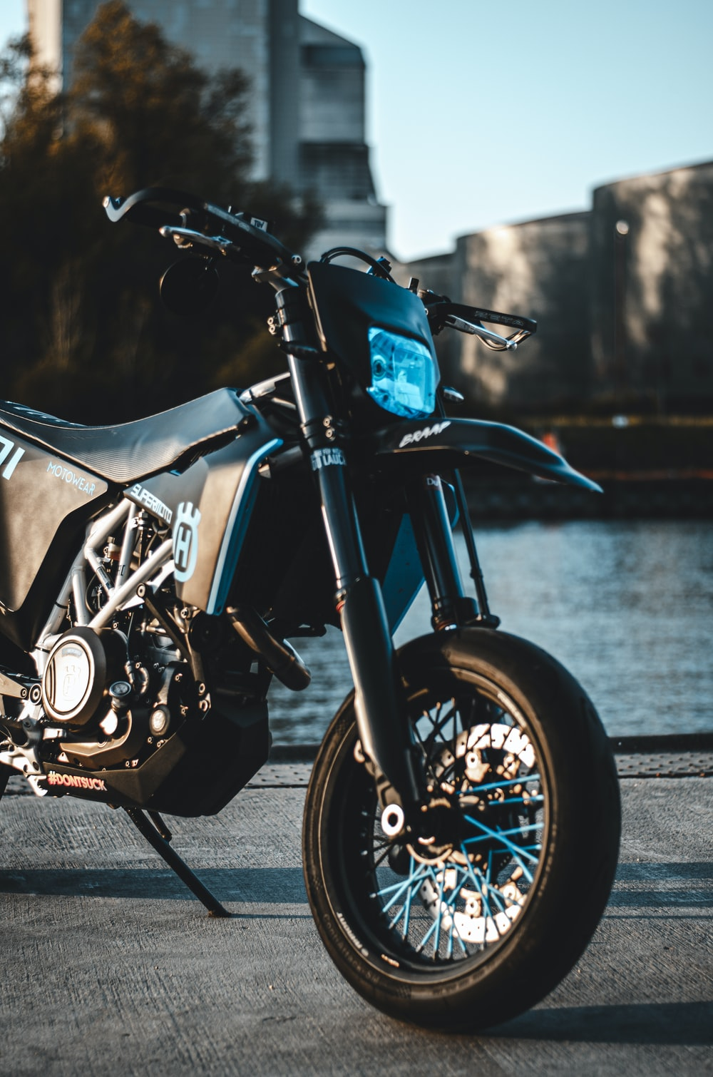 blue and black motorcycle on road during daytime