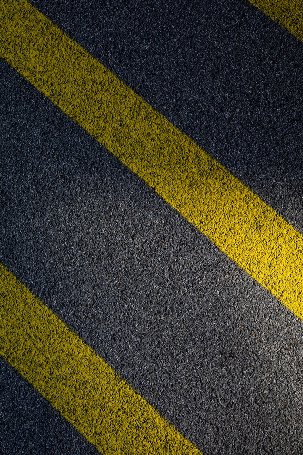 black and yellow line on gray concrete pavement