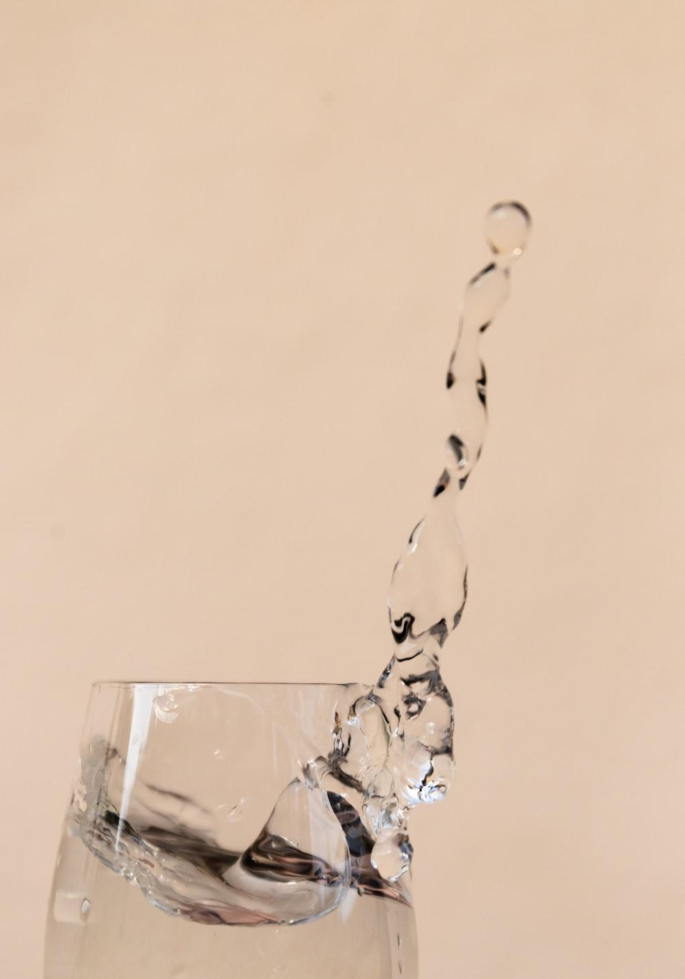 water splash on clear drinking glass