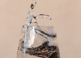 water pouring on clear drinking glass
