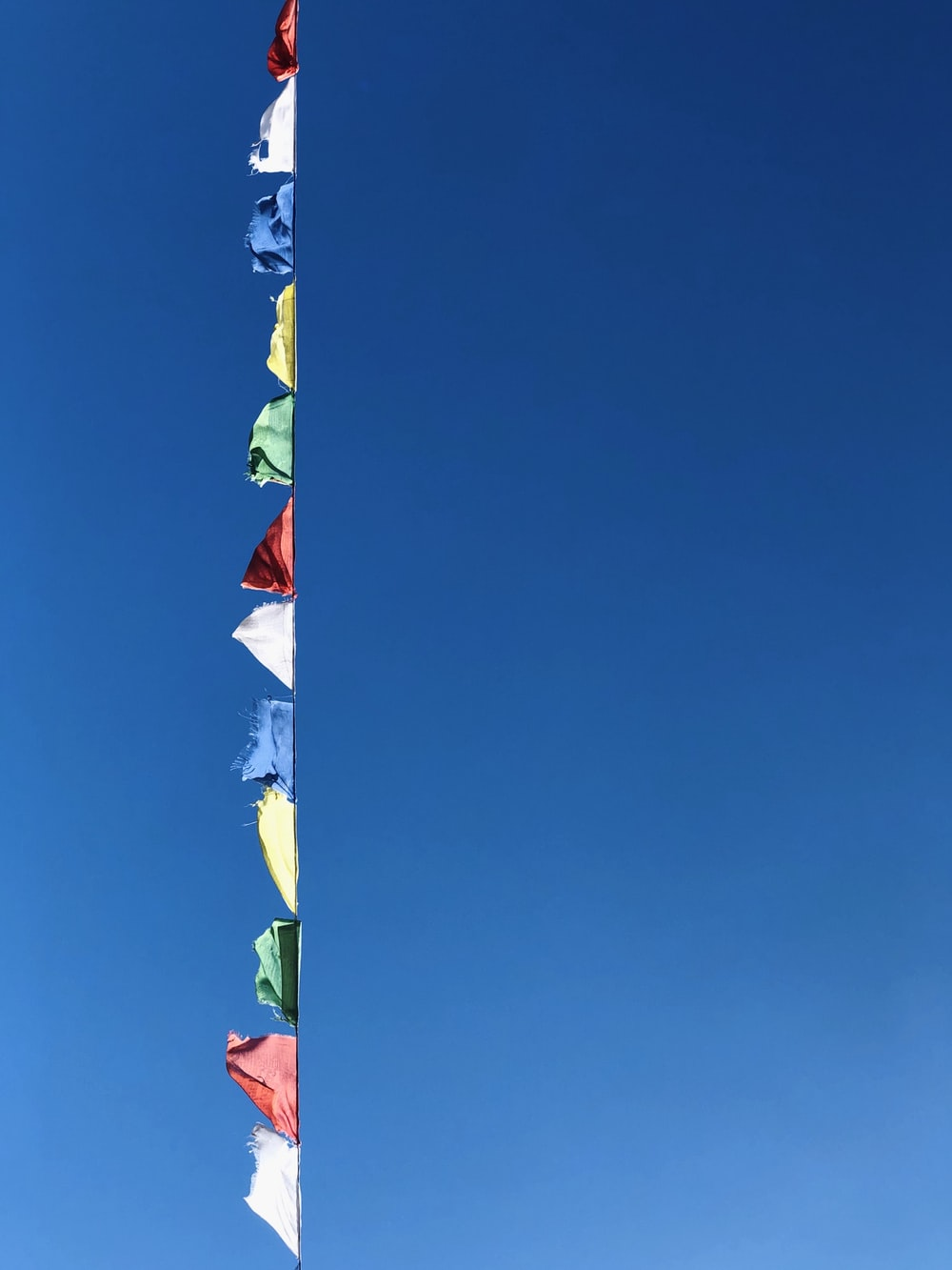white red and blue flag under blue sky during daytime