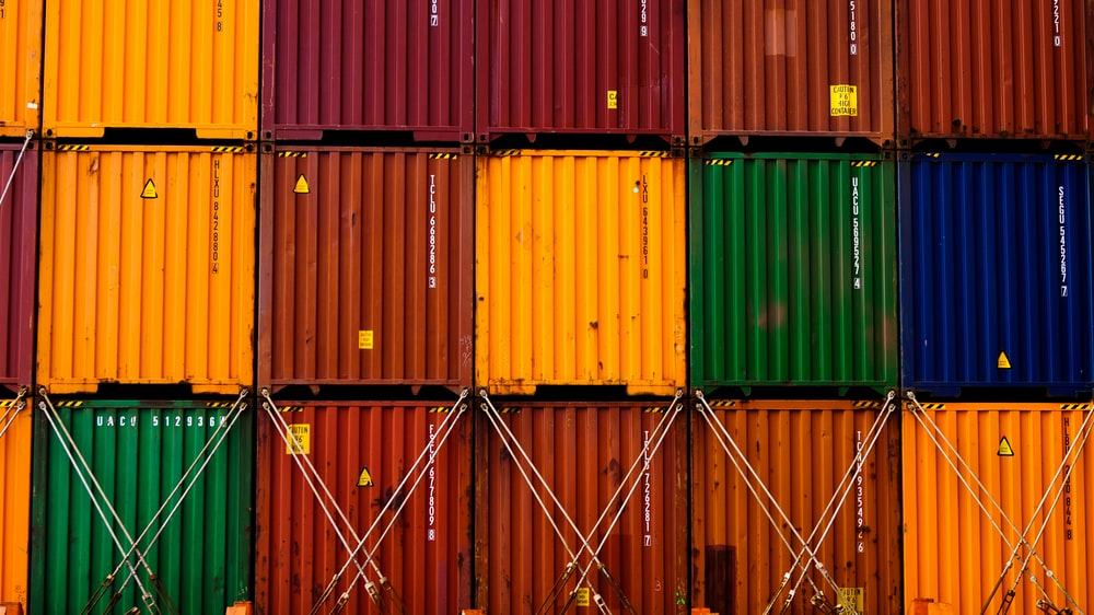 stack of red green and yellow wooden crates