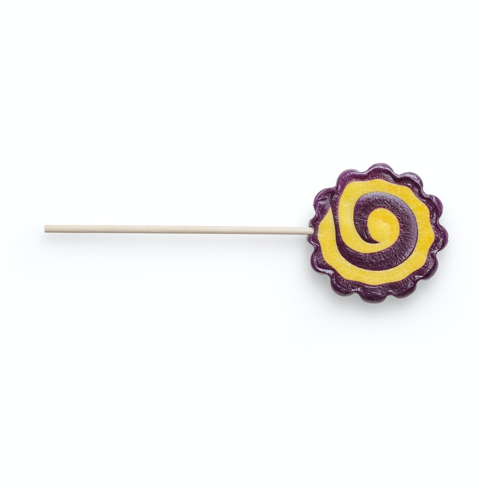 blue and yellow lollipop on white background