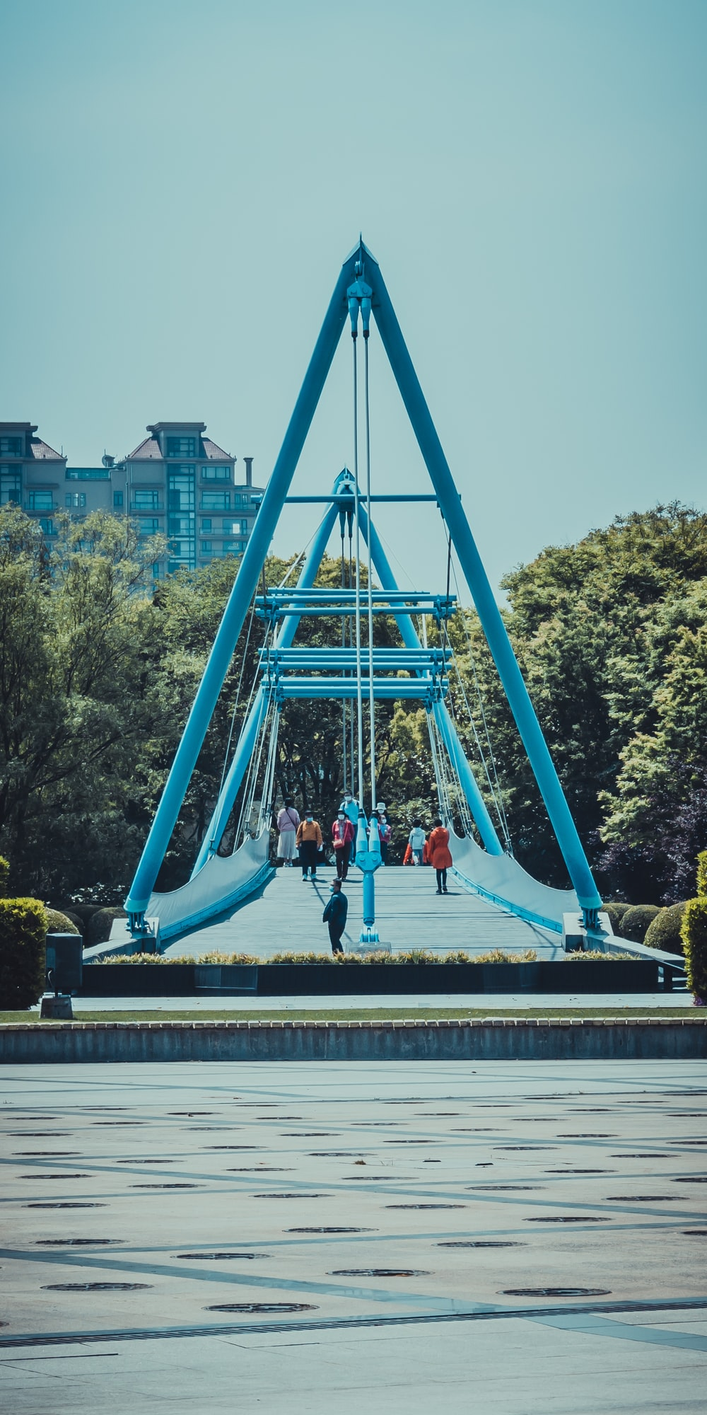 people standing on blue and green slide