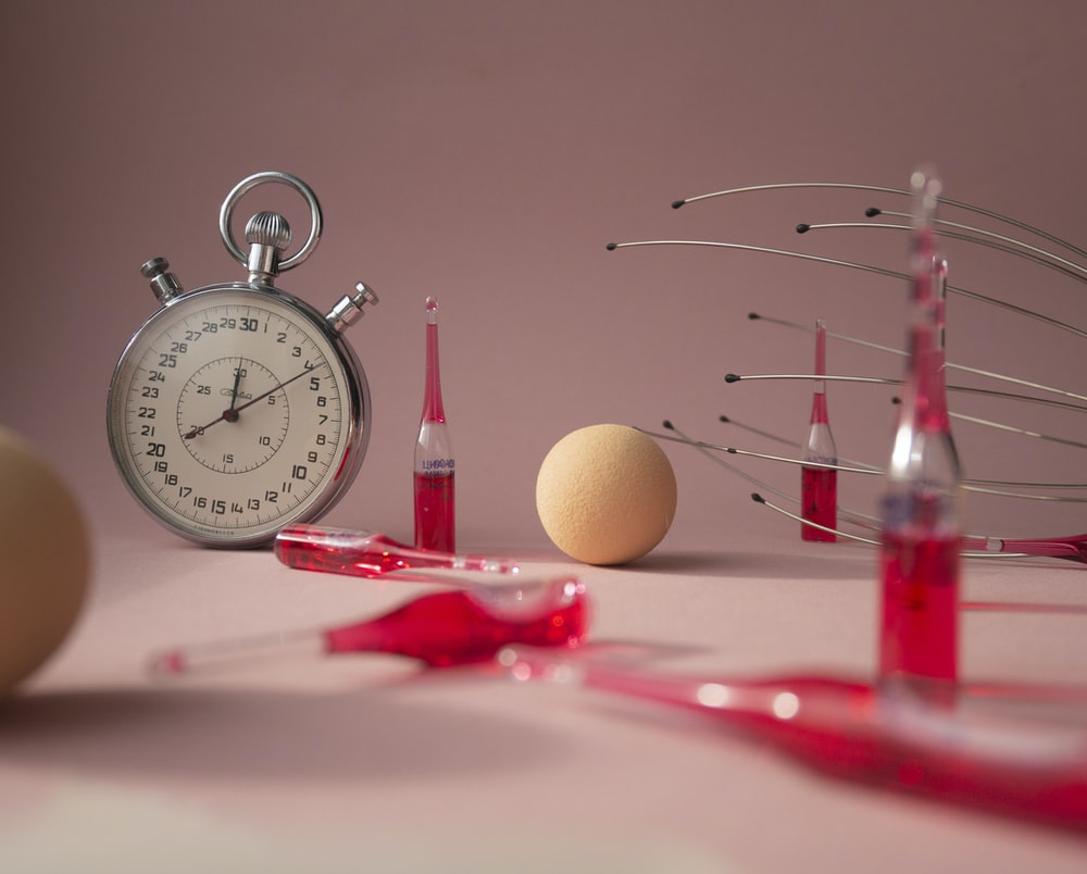 red and silver analog alarm clock