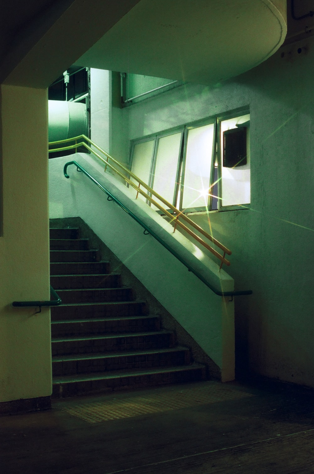 white metal staircase railings near window